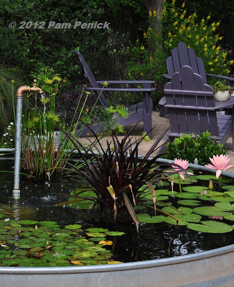 Plumbing pipe fountain adds life to stock tank pond digging for Digging a garden pond