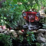 Pond and fountain made from the front grille of a vintage Willys Jeep in the garden of Shari Bauer