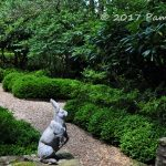 Hare statues adorn a stone wall at the entrance to a formal garden in Middleburg, Virginia