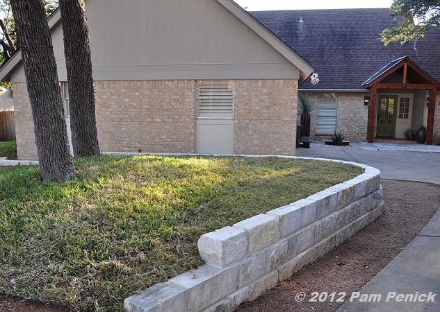 how to build a retaining wall on a sloped yard