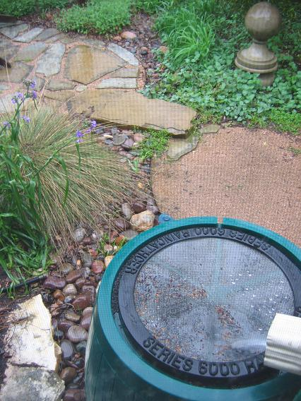 Water Flowing From The Gutter Into A Rain Barrel. The Overflow Spills Into  The Wet Weather Stream (dry Creek), Laid With New Mexico River Rock, ...
