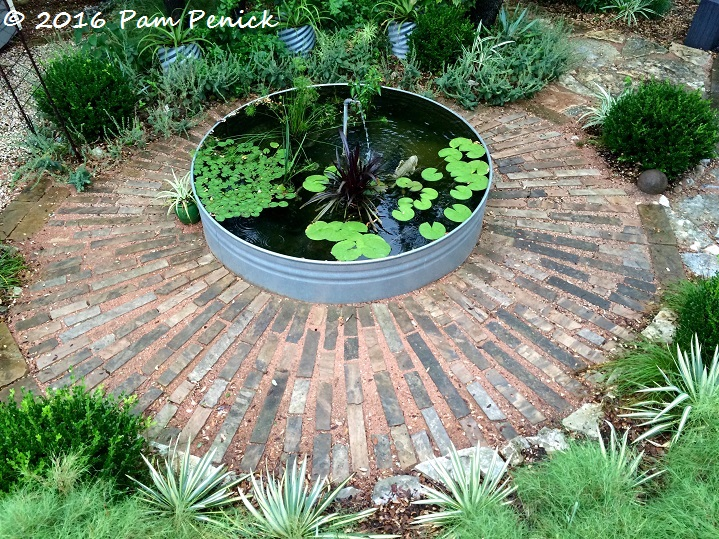 Stock tank pond garden is cool even in summer 39 s heat digging for Koi pond heaters for sale