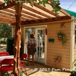 Greenhouse patio with shade arbor