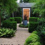 Shed with orange door and parterre garden, belonging to Virginia designer Scott Brinitzer