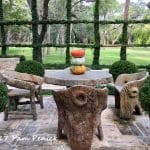 Faux bois seating and cedar trellis covered in fig ivy in San Antonio garden